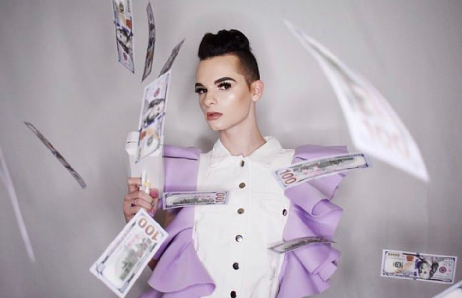 Braxton in a promo photo wearing makeup and costume with money flying around him