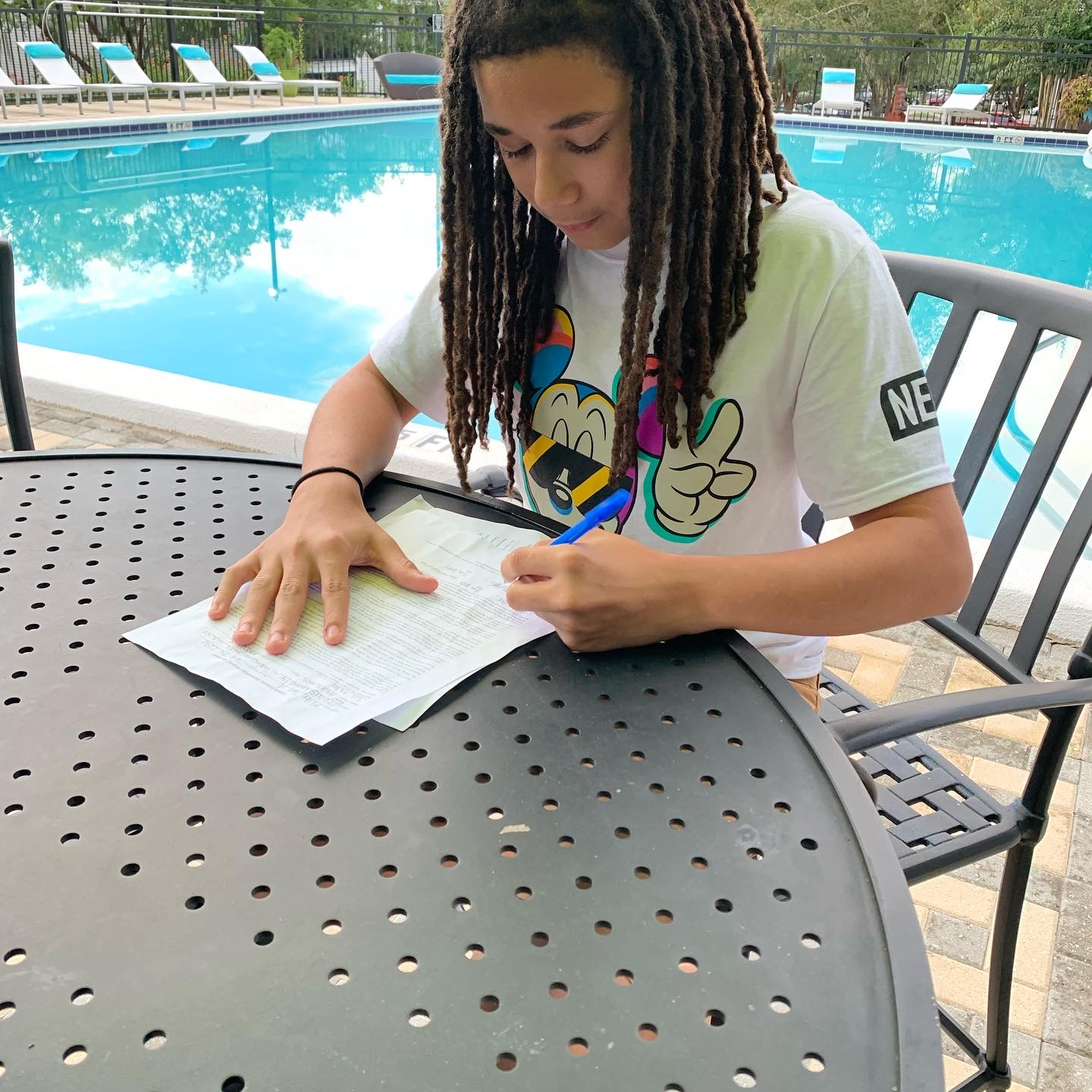 Juel Miller signing an agency contract